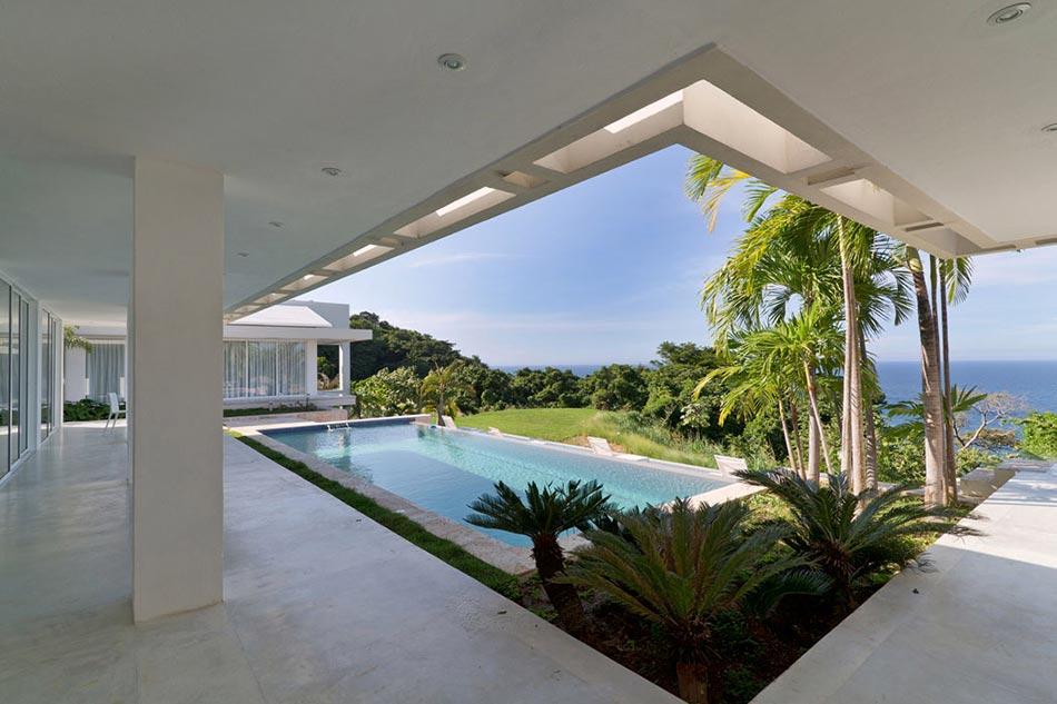 Villa contemporaine de plain pied aux cara bes avec belle vue sur la mer de - Architecture de villa moderne ...