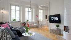 Salon spacieux en gris et blanc aux petits meubles design