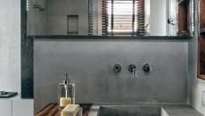 lavabo et mur en béton brut