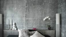 chambre à coucher aux murs en béton brut