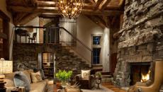 salon cheminée en pierre décoration rustique accueillante