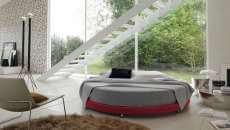 spacieuse chambre à coucher lit rond mobilier design