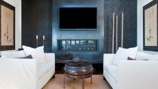 télé montée au-dessus de la cheminée salon luxe