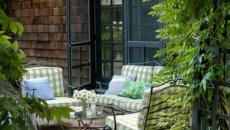 extension véranda fauteuils maison